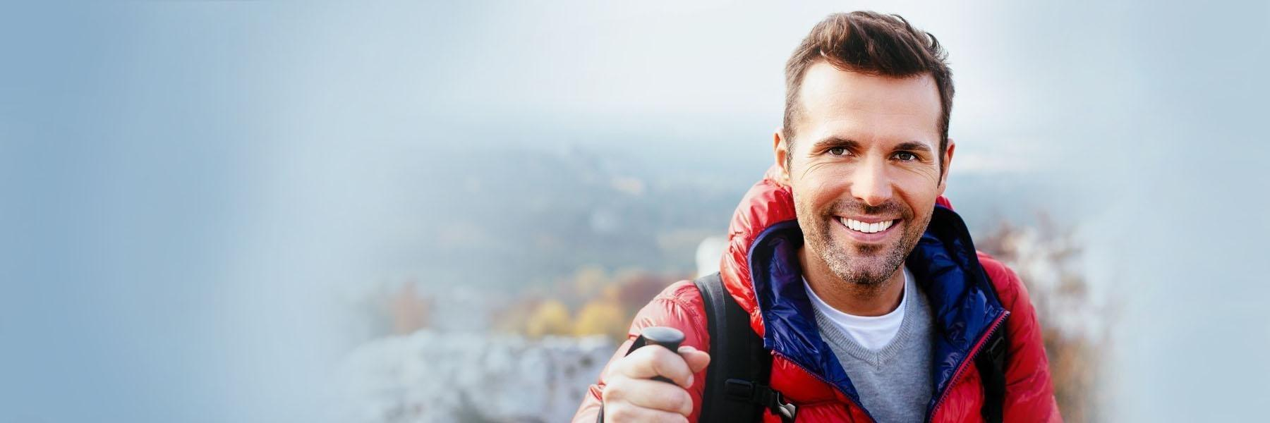 Man in red jacket smiling | Dentist Chesterfield MO